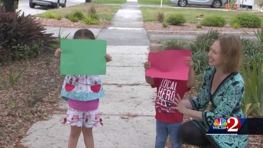Signs of Help: Orlando family creates system using window signs to help neighbors