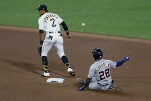 Tigers outslug Pirates 17-13 in 11 innings after layoff