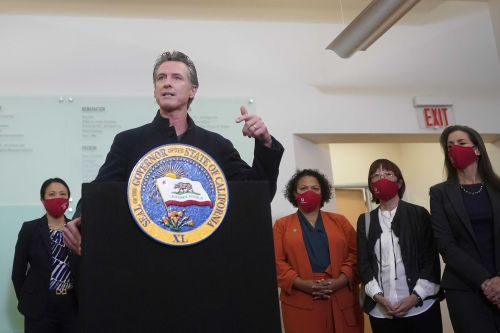 As California virus cases stop falling, governor urges caution