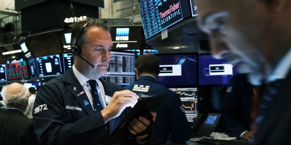 Stocks slip from records as optimism over economic recovery pauses