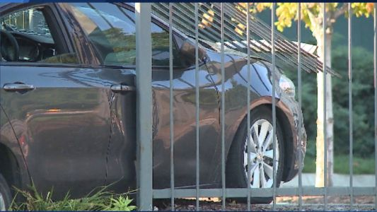 Car slams into fence, one person injured