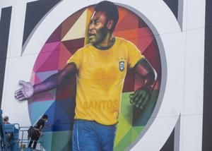 Pelé gets his first COVID-19 shot, urges mask use