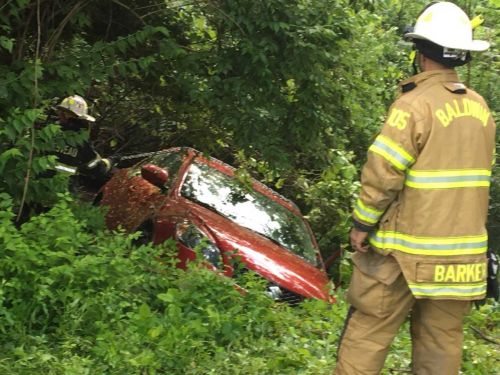 Man rescued after crashing and falling down hillside