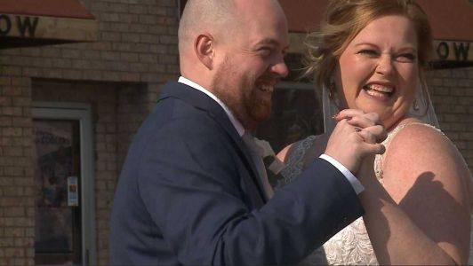 'Better than the wedding we planned': Iowa town surprises newlyweds with wedding parade