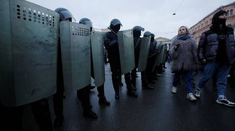 Riot cop visits hospital to apologize to woman he kicked in stomach during intense protests in St. Petersburg