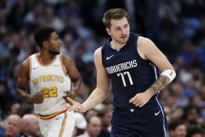 Doncic has 33 first-half points, Mavs hammer Warriors 142-94