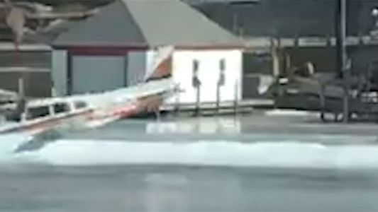 Plane spins out, strikes snowbank while landing on ice runway
