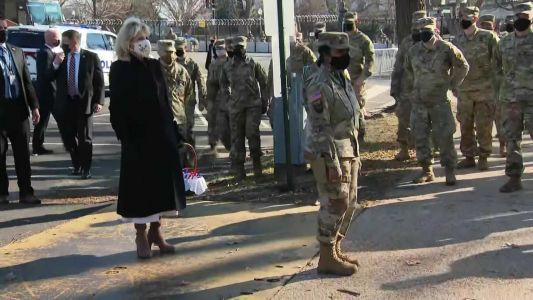 First Lady Jill Biden gives out cookies during surprise visit to National Guard troops