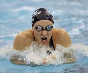 Olympian sues USA Swimming, saying it failed to protect her