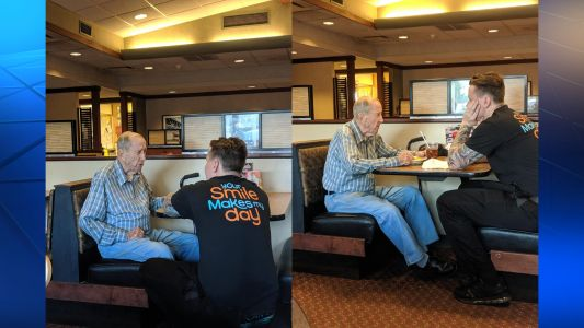 'I almost cried': Photos of restaurant server sitting and talking with 91-year-old veteran go viral