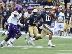 Perry runs, passes Navy past outclassed East Carolina 42-10