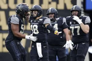 Vaughn scores twice as Vandy upsets No. 22 Missouri 21-14