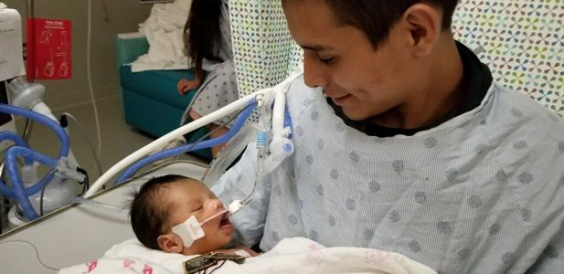 'We're praying this baby makes it': Baby cut from his mom's womb after she was killed opens his eyes
