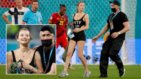 Money walks: Scantily clad pitch invader who interrupted Belgium and Finland at Euro 2020 was advertizing cryptocurrency