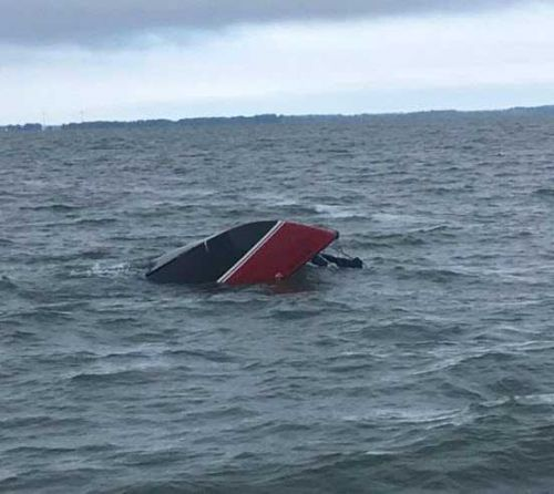 Man rescued on Lake Erie after clinging to capsized sailboat for 12 hours