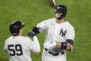 Judge homers, leaves early in Yankees' 9-6 win over Braves