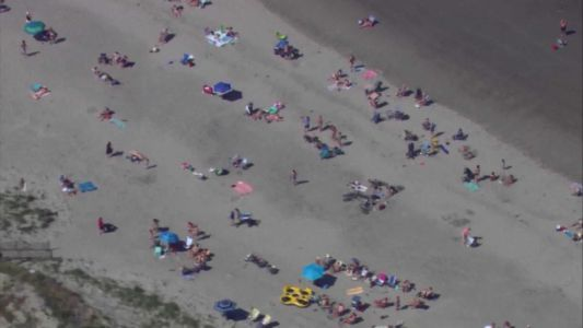 People return to Mass. beaches ahead of Memorial Day weekend