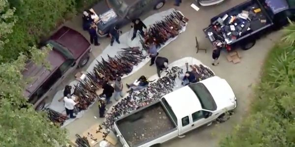 More than 1,000 firearms were confiscated during a raid on a home in a ritzy Los Angeles neighborhood