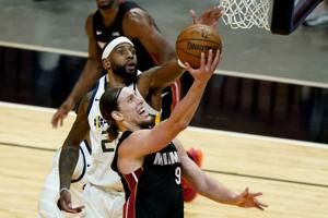 Butler, Dragic carry Heat past NBA-best Jazz, 124-116