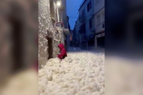 Sea foam floods streets of Spanish town during deadly storm