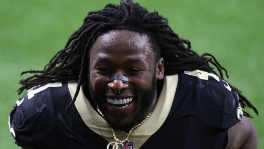 The story of Alvin Kamara's shimmering teeth: Big Saints contract helps buy expensive grills