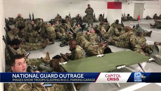 Images of National Guard troops sleeping in parking garages sets off firestorm