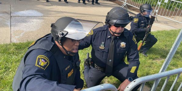 'We stand here just as outraged as they do': Cincinnati police chief, officers take knee with protesters