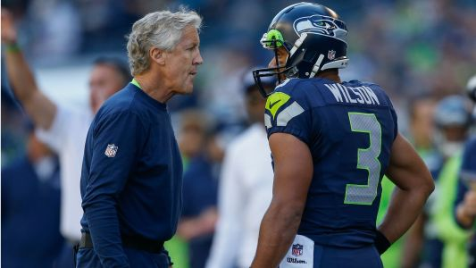 Seahawks coach Pete Carroll says Russell Wilson has been 'over-trying a little bit'