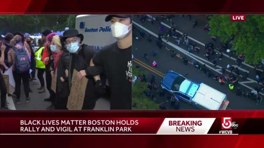 Protesters link arms to create path for Boston police caravan