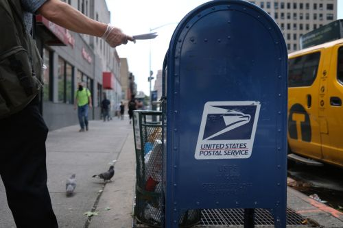 Postal Service chief denies slowing down election mail to assist Trump