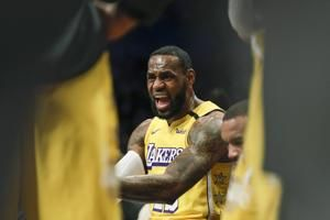 LeBron has triple-double, Lakers pull away to beat Nets