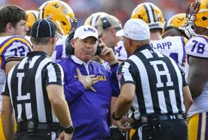 Kansas places Miles on administrative leave after LSU report