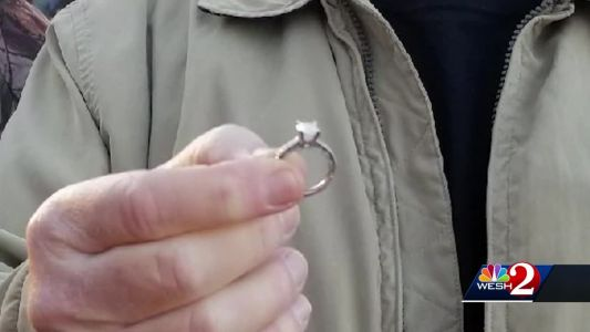 Workers retrieve diamond ring that was accidentally thrown in trash
