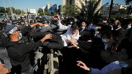 Orthodox Jews clash with police in Israel as some religious schools open in violation of lockdown