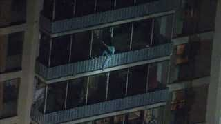 WATCH: Man escapes high-rise fire by climbing down it in true 'Spider-Man' style