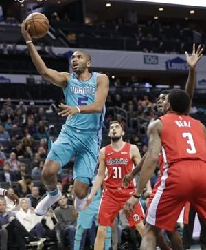 Hornets switch lineup, roll past Wizards 123-110