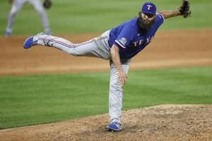 Lynn tosses 2-hit complete game, Rangers beat Rockies 3-2