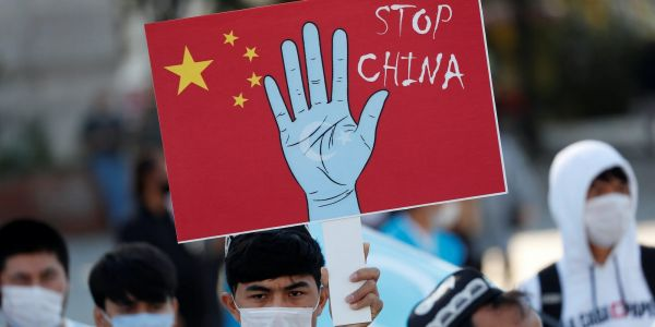 China is committing 'crimes against humanity' with its treatment of Uighurs in Xinjiang, human rights group says