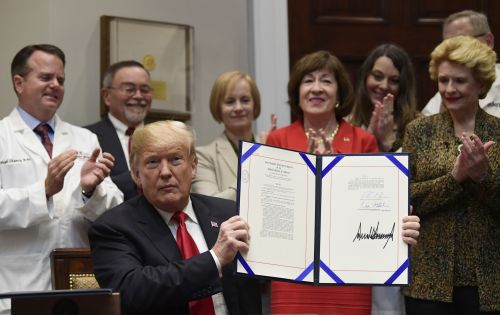 Trump signs bills to help patients stop overpaying for drugs