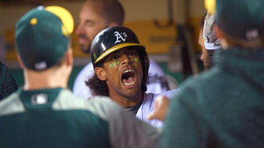 Khris Davis crushes homer while wearing jersey signed by young cancer survivor