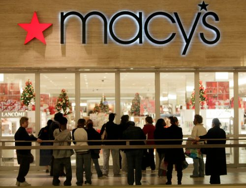 Macy's holiday sales dropped, but beat Wall Street estimates, as stimulus checks and strong online demand cushioned the blow of the pandemic