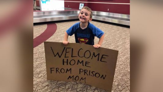 Boy's silly, embarrassing sign welcoming mom home at airport goes viral