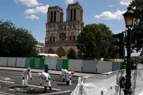 Lead scrubbed from Paris streets as Notre Dame work resumes