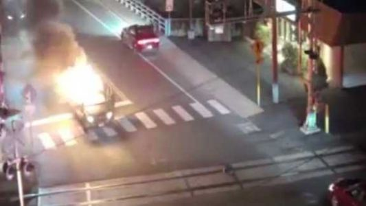 'You are a hero': Video shows man running toward burning car to save person trapped inside