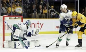 Sissons scores OT winner as Predators beat Canucks 4-3