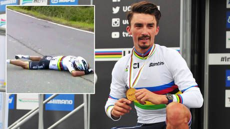 Down and out: Cycling world champ SCREAMS in pain after FLIPPING over top of bike in agonizing crash with race motorcycle