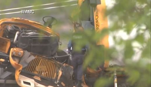 School bus ripped apart in collision with dump truck