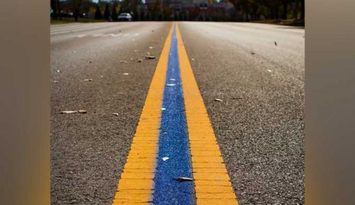 'Thin Blue Line' painted between yellow lane dividers to thank Florence Police Department