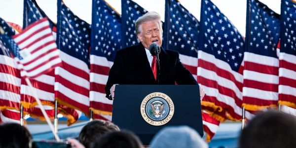 Trump tells farewell crowd 'we will be back' in rambling speech before skipping town ahead of Biden's inauguration