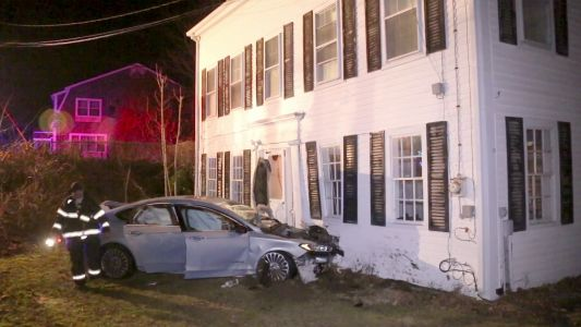 Car crashes into home in Sandwich